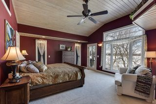 Master suite with T&G pine ceiling and views to lake