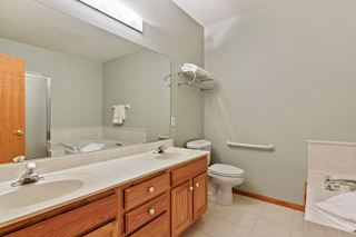 Owner's suite bath with double sinks.