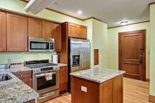 Hardwood floors and beautiful cabinetry throughout