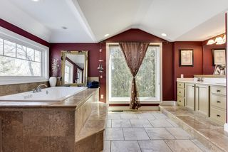 Spacious master bath with new tile and jacuzzi tub