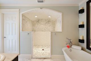 Master bath has large walk-lin shower and separate tub.
