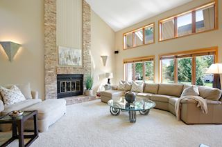 Great Room featuring vaulted ceiling, fireplace & views of the gorgeous backyard