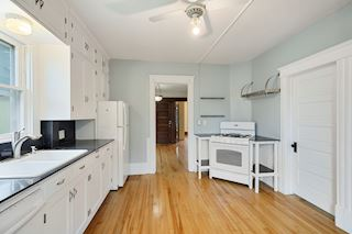 Upper Level Kitchen with Adjacent Laundry Room
