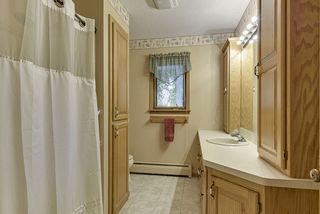 Full bathroom on main level features lots of cabinet space & linen