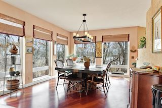 Formal dining room with plenty of windows for spectacular views and Brazilian Hardwood flooring