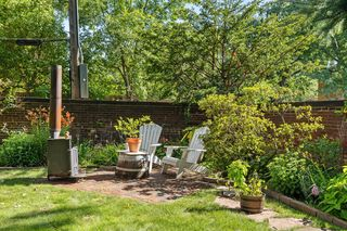 This backyard is perfect for BBQ's, games & chilling out by the firepit!
