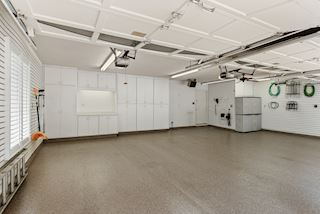 Epoxy floors and slat walls highlight this immaculate garage