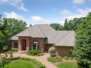 Stunning all-brick walk-out on an 8/10 acre lot