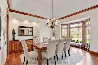 Formal Dining Room with built in serving buffet, tray vaulted ceiling