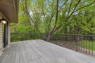 Deck overlooks wooded area