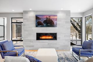 Gas fireplace on a tile wall