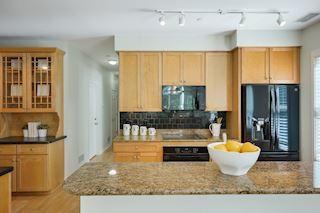 Granite counter tops and plenty of cabinet space in this kitchen