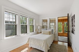 Bedroom has entry to 3 season porch overlooking Minnehaha Creek.