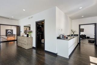 Breakfast Bar and Generous Walk-In Closet in Owner's Suite with adjacent Work Out Room