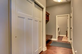 Large mudroom are with bench and huge closet