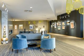 Main floor lobby with fireplace and lounge are great gathering spots. The association hosts rotating art installations.
