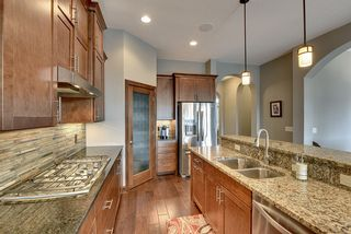 Stainless Steel appliances and corner walk-in pantry