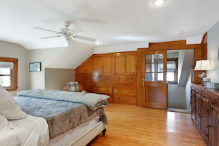 Master Suite with deep built-in cabinets, hardwood floors
