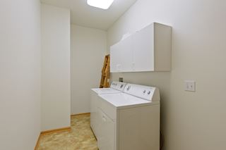 Full sized laundry with room for storage.