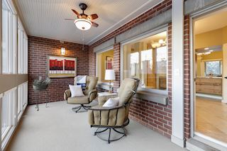 Private three season porch off main floor master bedroom and bath. Private with spectacular views of downtown and the river.