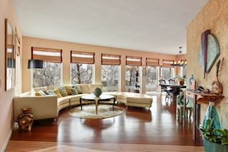 Formal living room with plenty of windows for spectacular views.