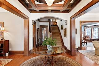 Gracious entry with crystal chandelier and coffered oak ceiling.