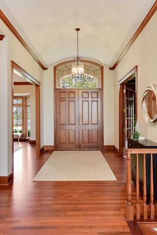 Dramatic front entry - double doors, barrel vaulted ceiling