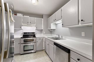 Stainless Steel appliances, lots of cabinets for storage  and  countertops for working space