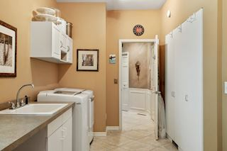 Huge laundry room! 21 x 7 With plenty of cabinetry and storage. LG washer and dryer included