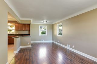 This Greatroom is excellent for entertaining- Cook & Visit- Move in Ready for the Holidays!