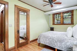 Bedroom with hardwood floors and ample closet space.