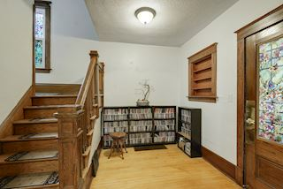 Notice the beautiful hardwood floors throughout the home and the original built in.