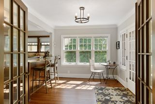 Remodeled kitchen, breakfast bar and informal dining open via original French doors.