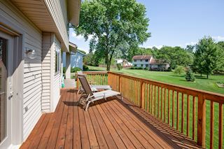 Enjoy sunny days with a cold beverage on your huge deck