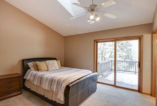 Vaulted master suite with private full bathroom & walk in closet