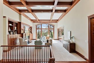 Grand living area - coffered ceiling, fabulous windows, beautiful westerly views