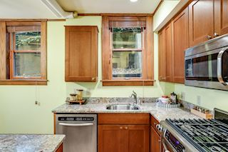 Kitchen with granite counter tops, undermount sink and upgraded appliances