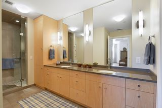Wonderful master bath with double vanity and abundance of custom cabinetry