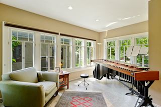 Sun Room with terrazzo floors perfect for so many uses ~ three walls of windows!