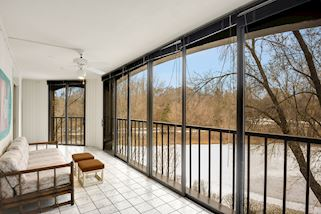 3-season Porch with views of pond, patio, walking path