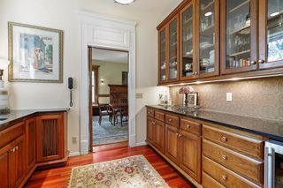 Butlers pantry with wine chiller & built-in cabinets & china storage - Main Level