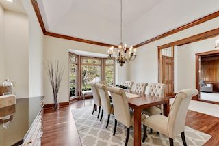 Formal dining room has newly refinished floors, bay window ... space for gatherings large or intimate