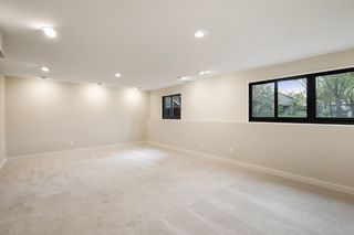 Lower level family/media/play room with newer windows - light and bright