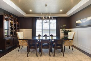 Enjoy entertaining family and friends in this elegant formal dining...