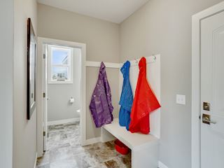 Back mud room- adjacent to large walk-in closet for all the coats & boots and main floor powder room-