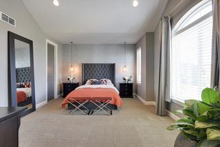 Elegant master suite with double walk-in closets...