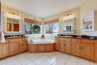 Master bathroom with two separate vanities and Jacuzzi tub
