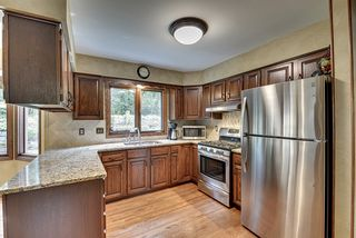 Kitchen features granite countertops, new stainless steal appliances and neutral tile backsplash.