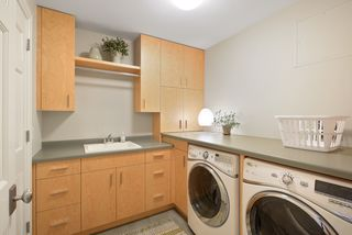 Nice sized Laundry with full sized washer & dryer, sink and cabinets
