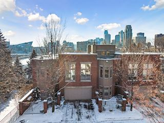 Rarely available Lourdes Square end-unit townhome.